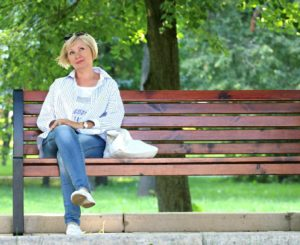 woman sat on a bench
